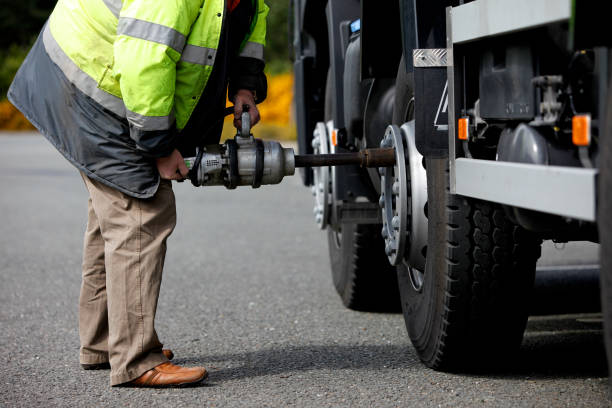 changing the tire on a truck - truck tire foto e immagini stock