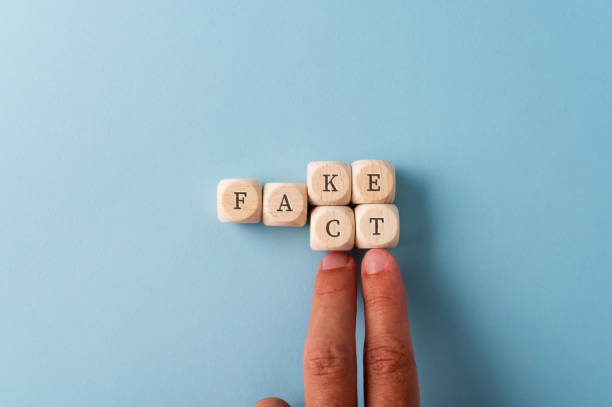 Changing the word Fake into Fact stock photo