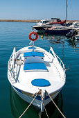 Greek fishing boat moored in the port city of Chania. Crete.