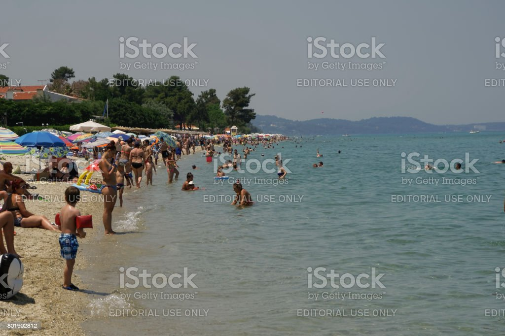 Chaniotis, Greece. June 24 2017: locals and tourists on the beach on a hot day. stock photo