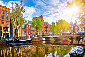 Channel in Amsterdam Netherlands houses river Amstel landmark old european city spring landscape.