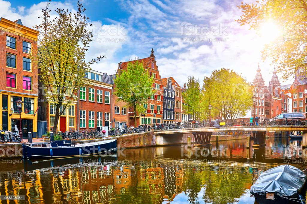 Channel in Amsterdam Netherlands houses river Amstel stock photo