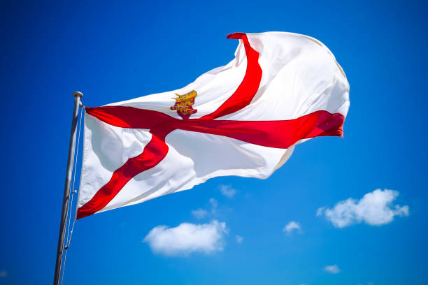 Channel Islands Jersey flag against blue sky stock photo