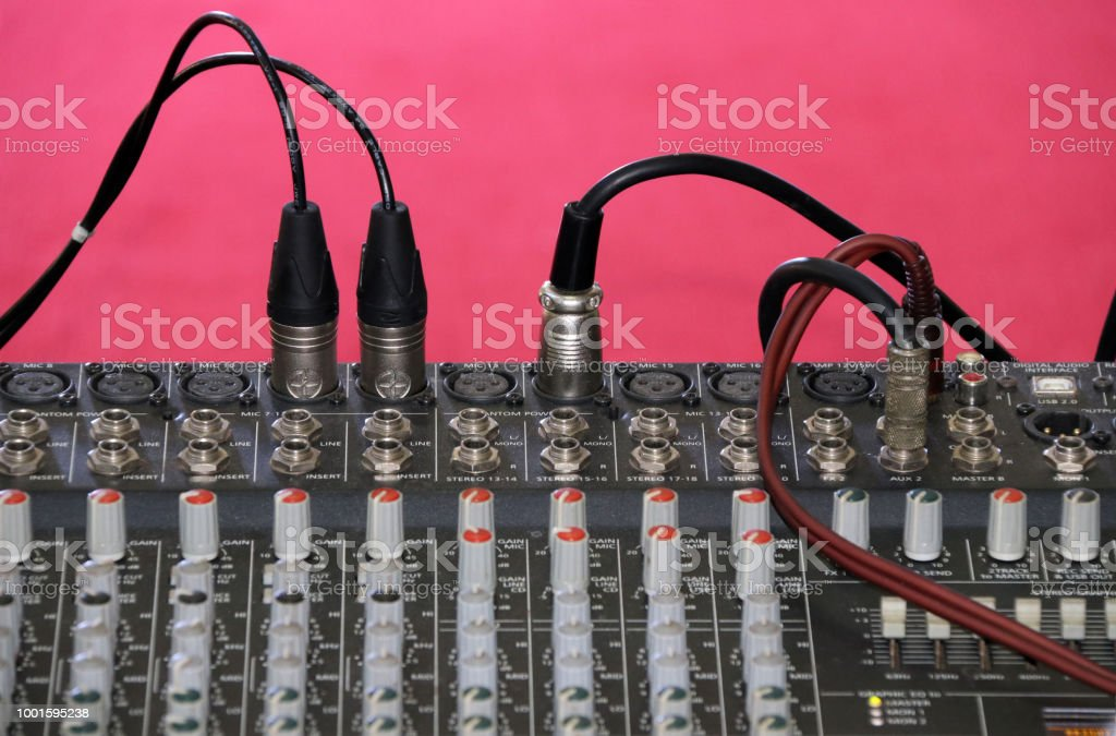 Channel Mixer for sound audio. mixing console for electro acoustics with red background. stock photo