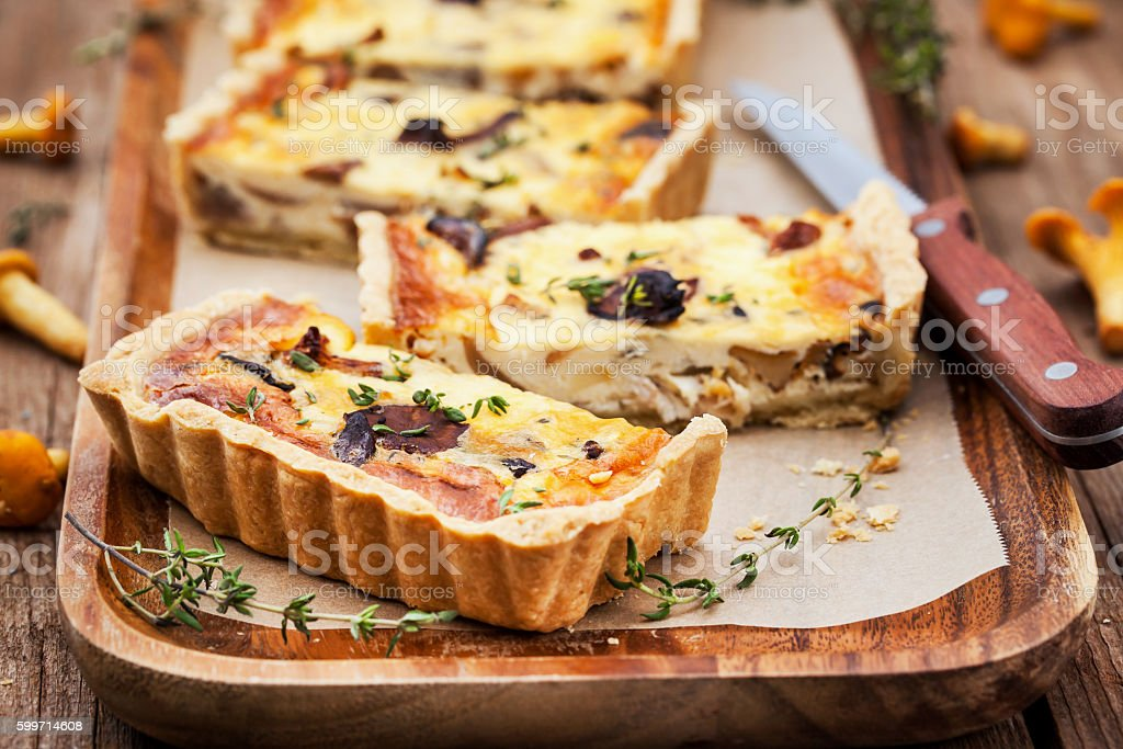 Chanterelle mushroom, cheese and thyme quiche stock photo
