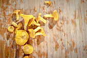 Chanterelle mushrooms over old wooden table.