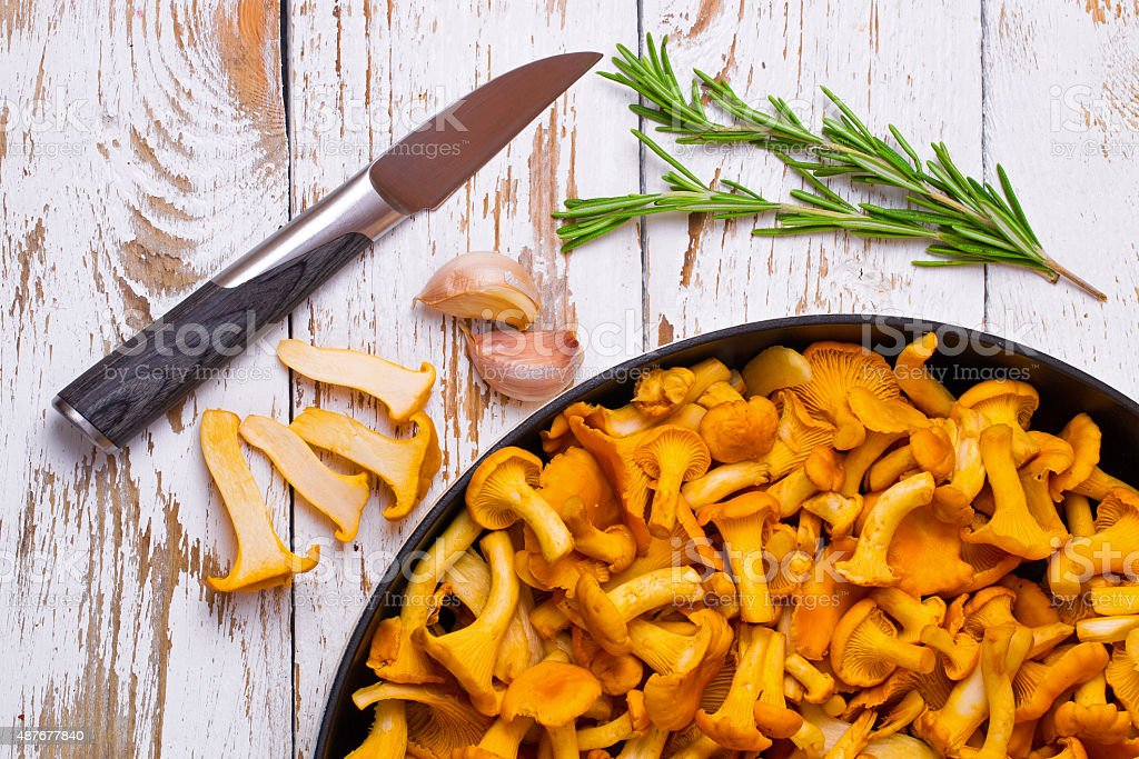 Chanterelles and knife on a table stock photo