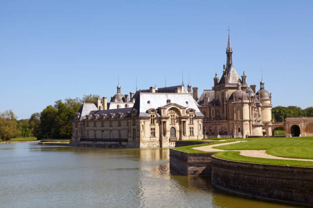 Chantilly castle in Hauts-de-France Chantilly, France - May 26 2012: Château de Chantilly in the department of Oise in Hauts-de-France. picardy stock pictures, royalty-free photos & images