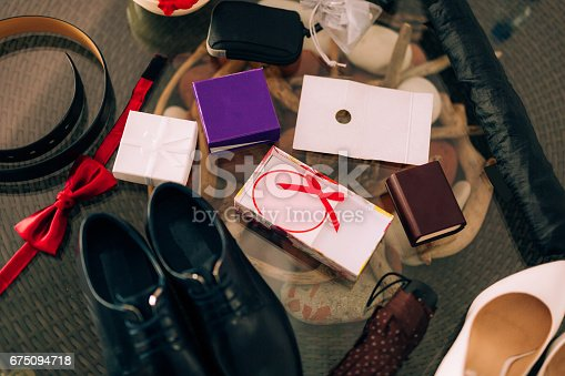 istock Chaos on the table. Wedding attributes: shoes, rings, belt and o 675094718