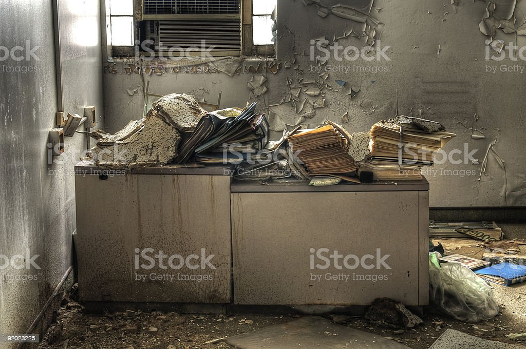 Chaotic office desk in an abandon house royalty-free stock photo
