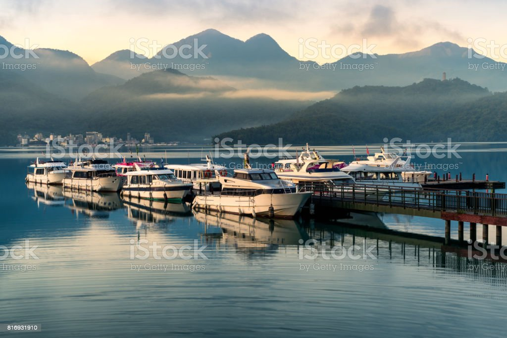 Chaowu Pier at dawn with beautiful mist and mountain in background, Sun moon lake, Taiwan stock photo
