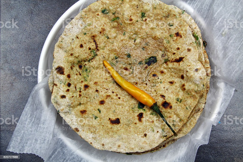 Chapati with chopped spinach leaves stock photo