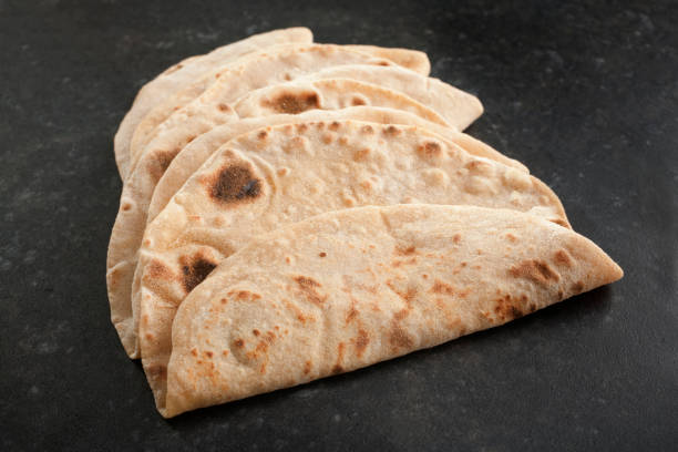 Chapatis, Home Made, on a Dark Background stock photo