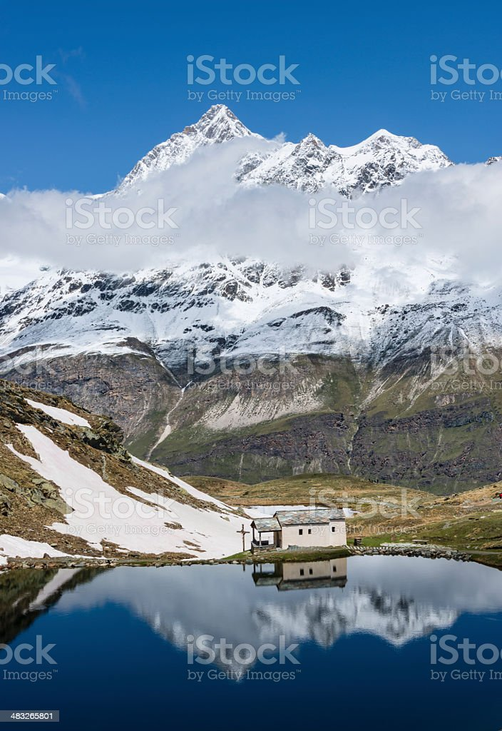 Chapel and mountains reflected in a small lake -XXXL royalty-free stock photo