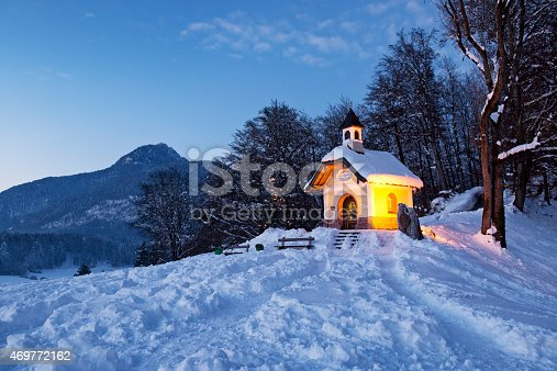 Chapel at Lockstein at sunset with Christmas tree in front of mountain, Berchtesgaden, Germany.