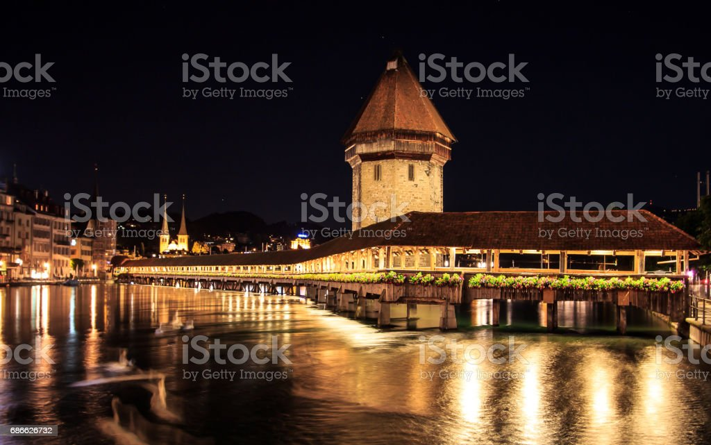 Chapel Bridge and Water Tower at night with reflection on the lake, Lucerne, Switzerland royalty-free stock photo