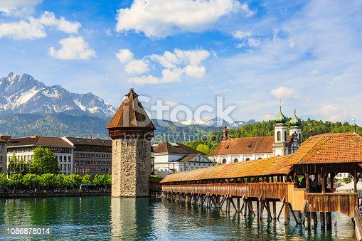 Chapel Bridge (Kapellbrucke) across the Reuss river and octagonal water tower, the main tourist attraction of Lucerne, Switzerland
