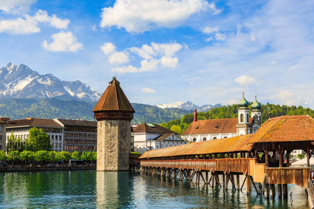 chapel bridge (kapellbrucke) and water tower - lucerne stock pictures, royalty-free photos & images