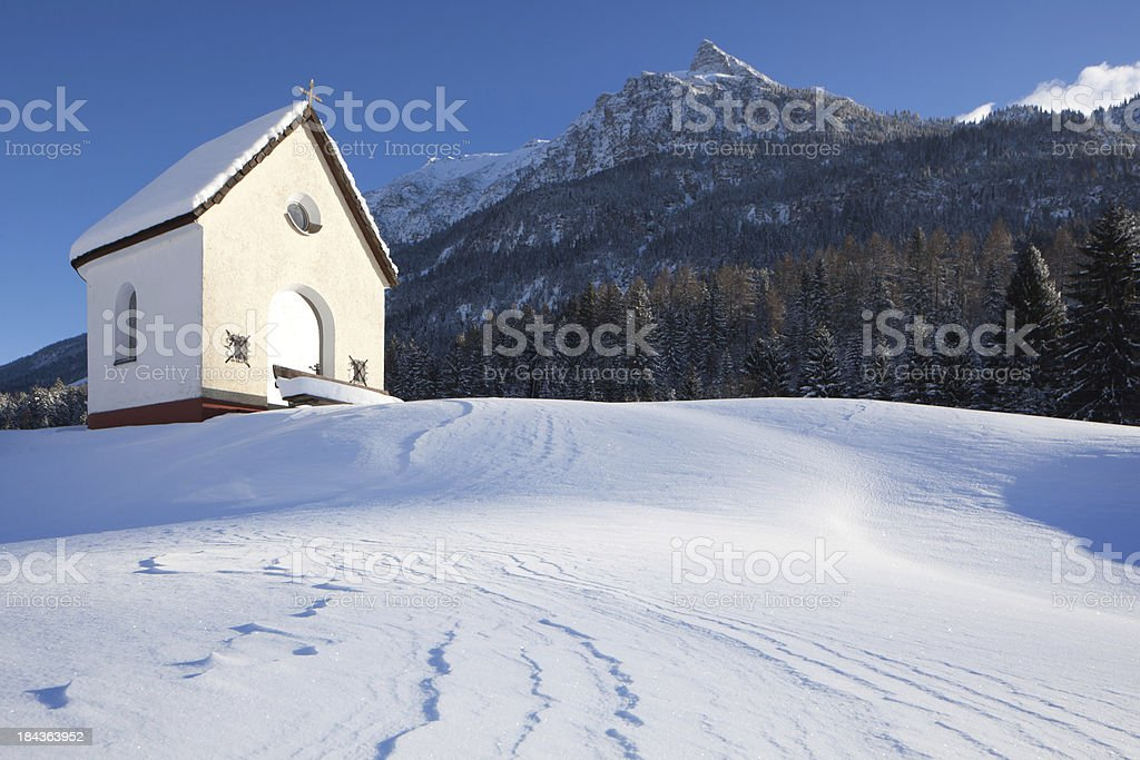 chapel in a snow covered winter landscape, tirol, austria stock photo
