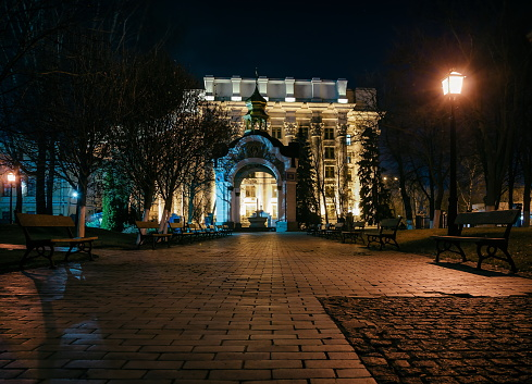 Chapel in the park near the St. Michael's Golden Gate Cathedral and park at night. A cobbled path and benches near the St. Michael's Golden Gate Cathedra. Kyiv, Ukraine