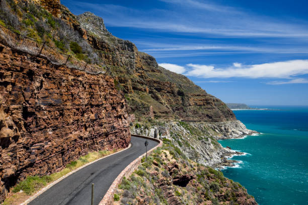 Chapman's Peak Drive near Cape Town on Cape Peninsula - Western Cape, South Africa. Chapman's Peak Drive is a 9 kilometer long coastal road from Hout Bay to Noordhoek, passing Chapman's Peak mountain. Chapman's Peak Drive near Cape Town on Cape Peninsula - Western Cape, South Africa. Chapman's Peak Drive is a 9 kilometer long coastal road from Hout Bay to Noordhoek, passing Chapman's Peak mountain. hout stock pictures, royalty-free photos & images