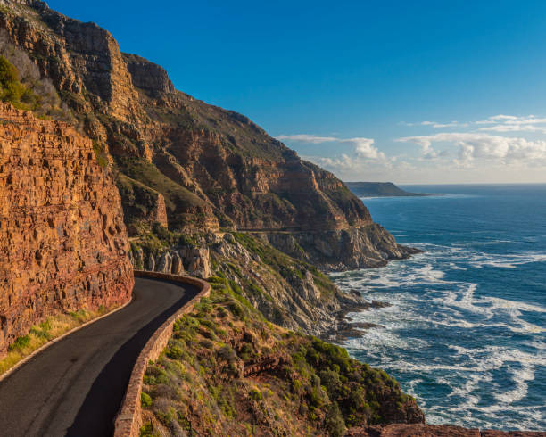 Chapmans Peak Drive Driving from Hout Bay, near Cape Town, along the twisty Chapmans Peak Road, the scenery is spectacular, as the road is cut into the rocks with the ocean just below. hout stock pictures, royalty-free photos & images