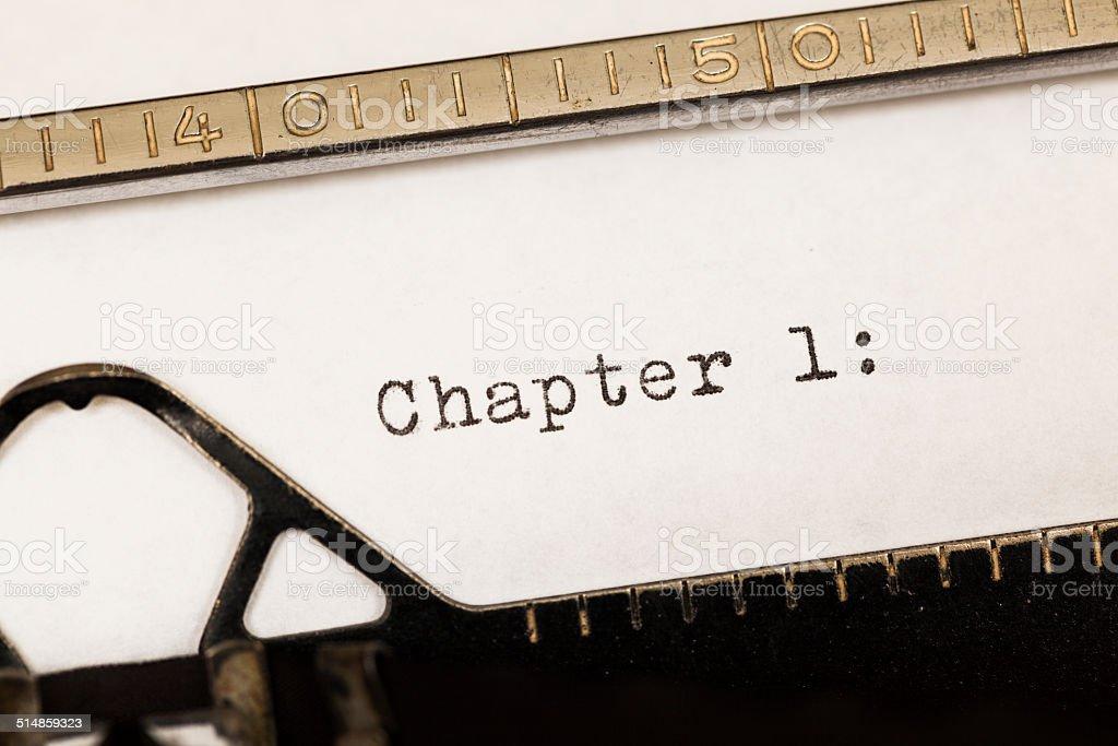 Chapter 1 written on old typewriter. stock photo