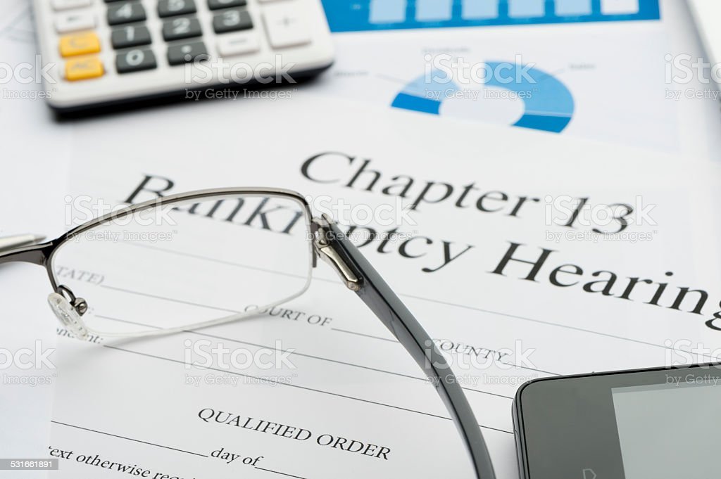 Chapter 13 bankruptcy form with paperwork stock photo