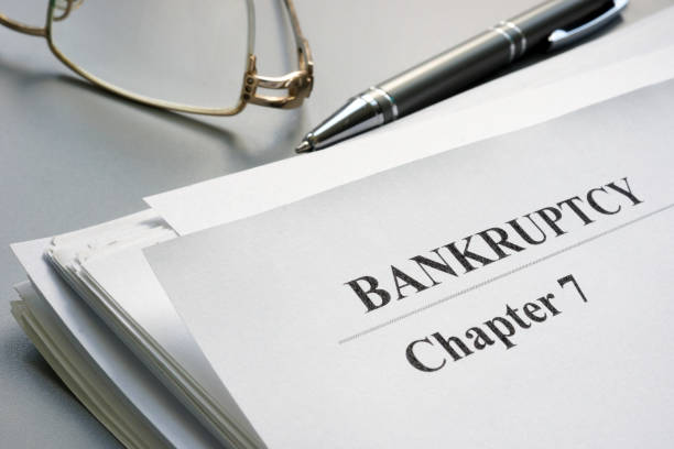 chapter 7 bankruptcy petition and glasses. - bankruptcy stock pictures, royalty-free photos & images