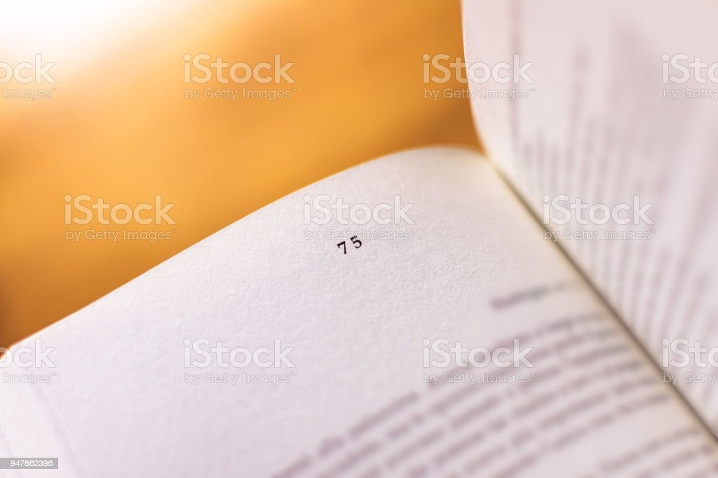 Chapter 75 of a Reading Book stock photo