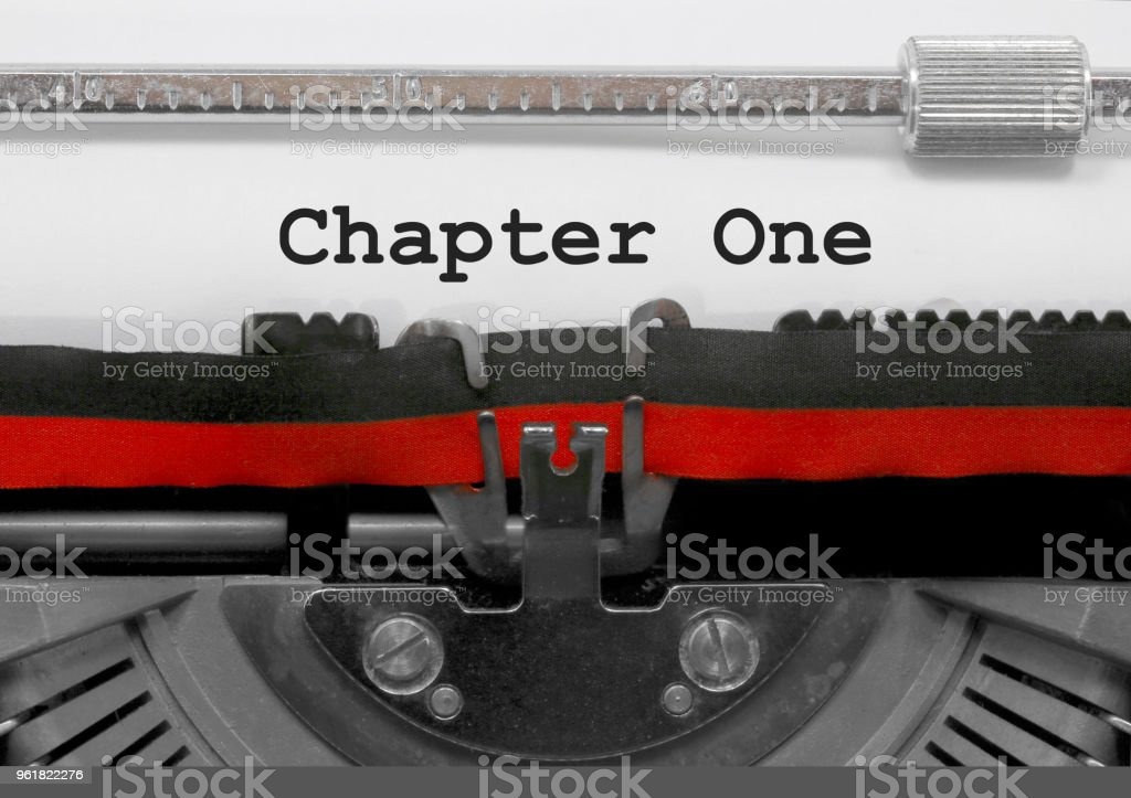 Chapter One by the old typewriter on white paper stock photo