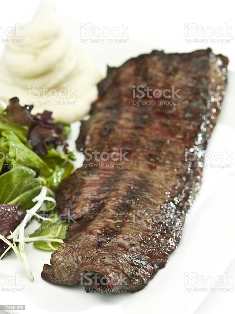 Char grilled beef steak, salad and mashed potatoes stock photo