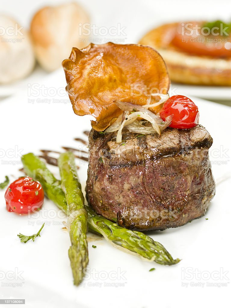 char grilled Fillet Mignon with asparagus and cherry tomatoes royalty-free stock photo