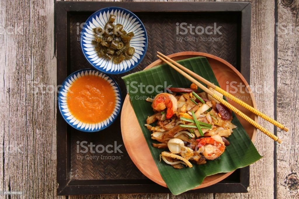 Char Kway Teow on Wooden Plate stock photo