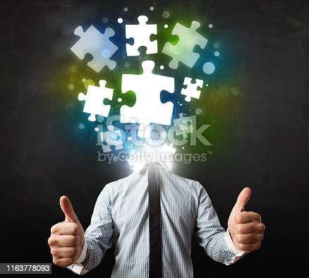 861553788 istock photo Character in suit with puzzle head concept 1163778093