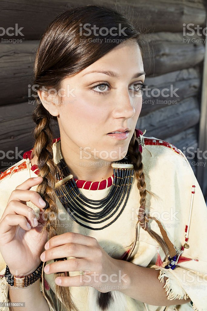 Character:  Young female portrays Native American Indian culture. stock photo