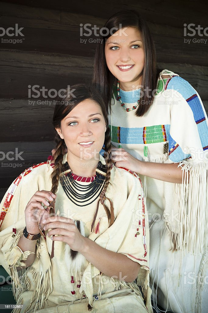 Character:  Young females portray Native American Indian culture. royalty-free stock photo