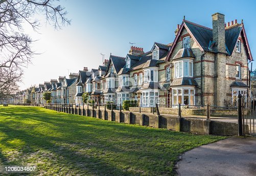 Characterful terraced houses on Park Parade facing Jesus Green in the city of Cambridge, UK.