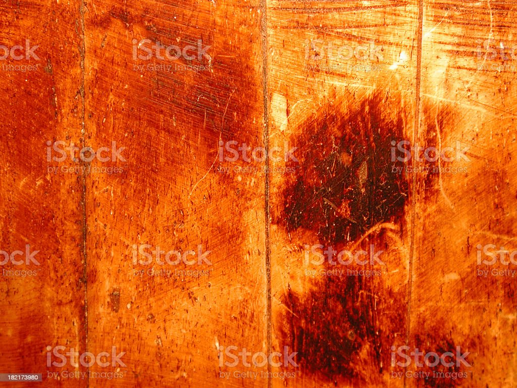 A characterful wooden background showing burns and scratches royalty-free stock photo