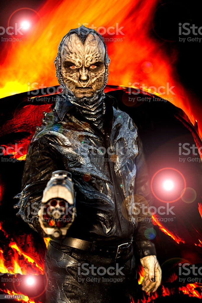 Characters: Alien points gun. Volcano, lens flare background. stock photo