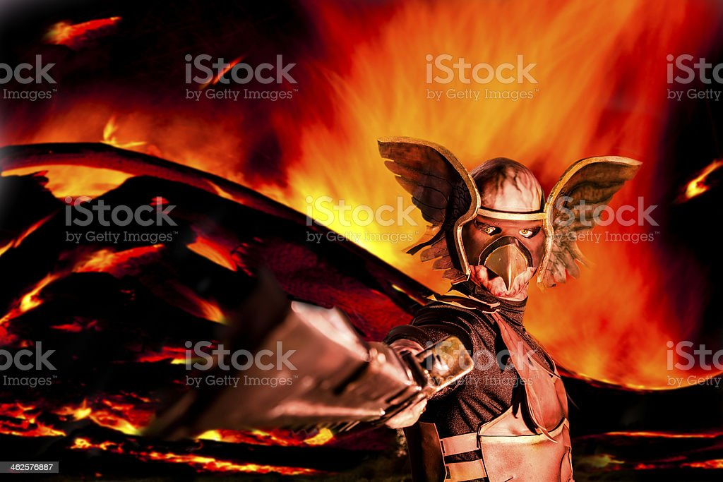 Characters: Winged warrior raises his sword. Explosive fire background. stock photo