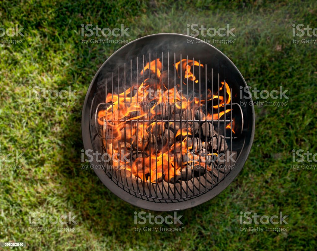 charcoal bbq in the backyard on grass stock photo 598082946 istock