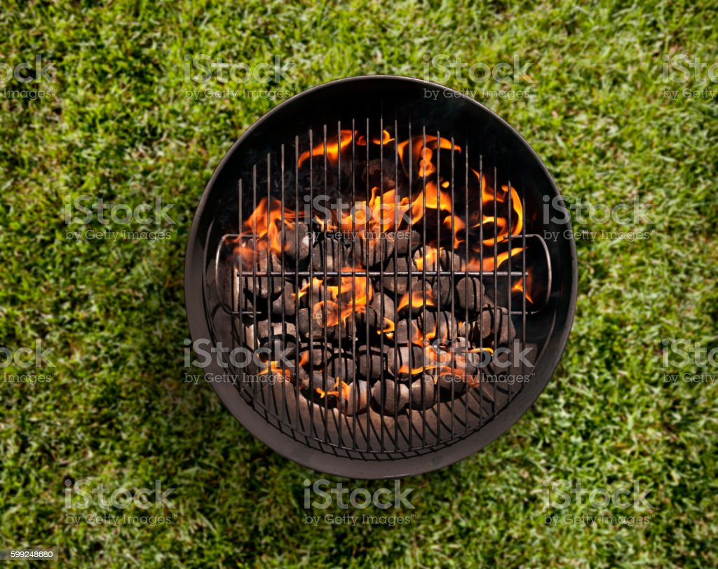 Charcoal BBQ in the Backyard on Grass stock photo