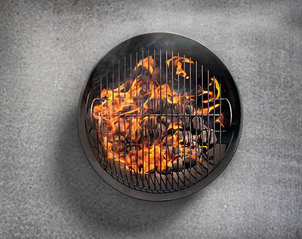 Charcoal BBQ on a Concrete Patio Charcoal BBQ on a Concrete Patio-Photographed on a Hasselblad H3D11-39 megapixel Camera System directly above stock pictures, royalty-free photos & images
