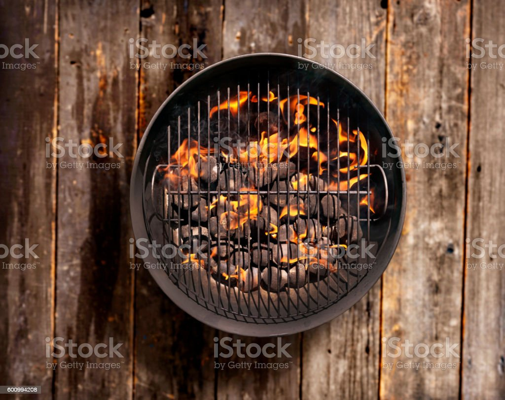 Charcoal BBQ on a Wood Deck stock photo
