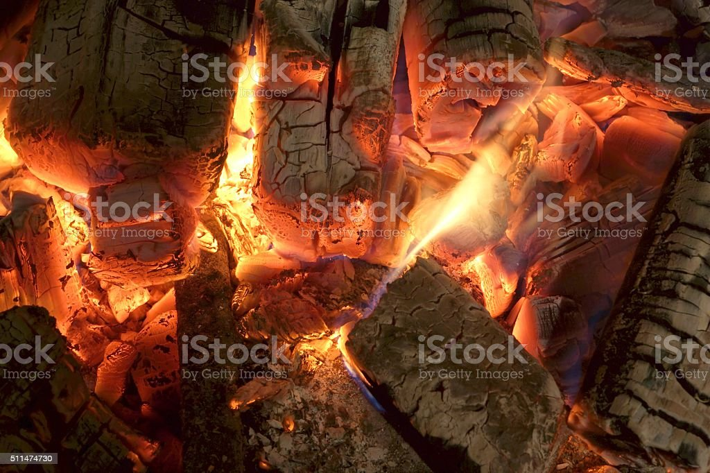 Charcoal Briquettes Glow In BBQ Grill Pit Background Texture stock photo
