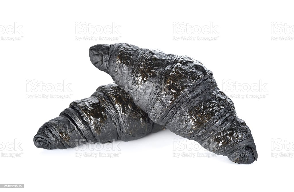 Charcoal croissant on white background foto royalty-free