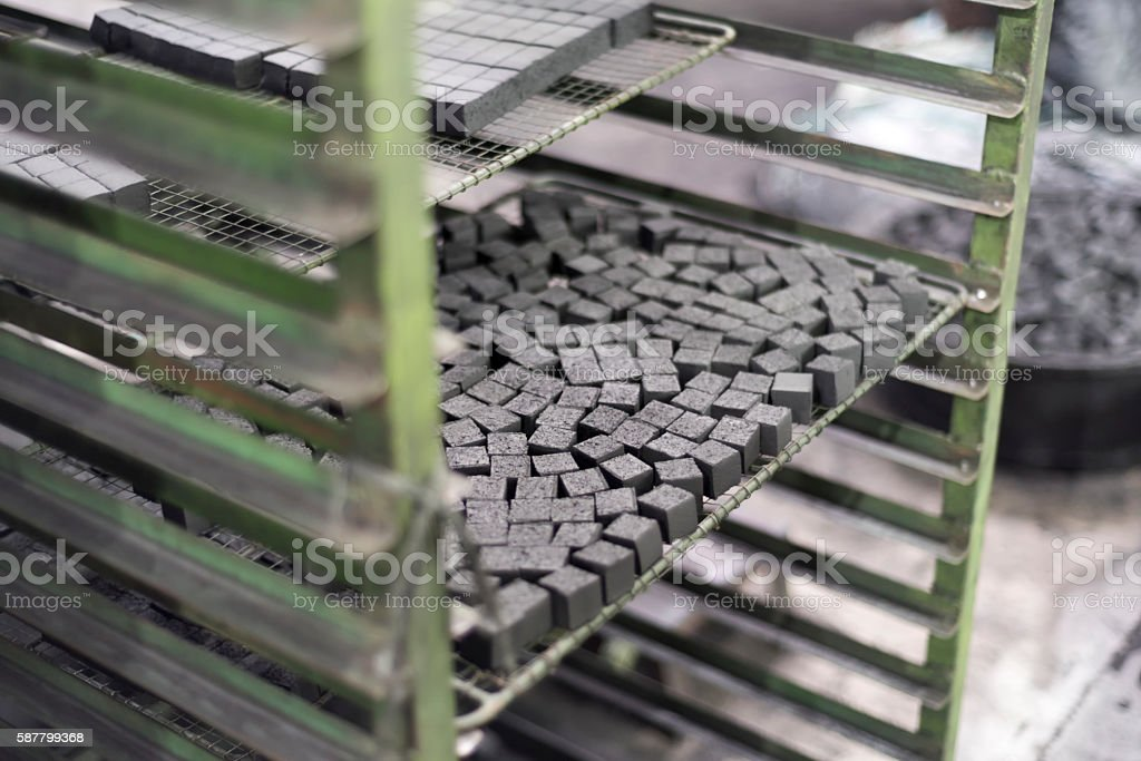 Charcoal cubes for shisha in the dryer stock photo