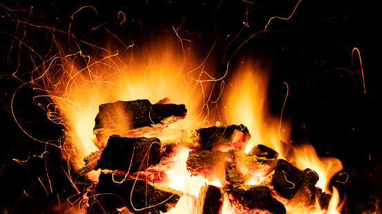 Charcoal fire burning.on a black background. Ideal for compositing with another image. The background can be removed with a blending mode like screen