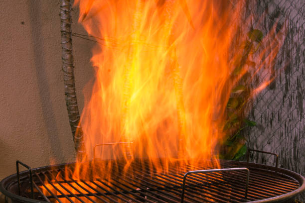 Charcoal fire on a BBQ grill stock photo